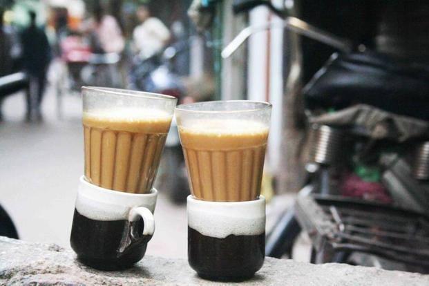 Glass tumblers held in a ceramic cups.